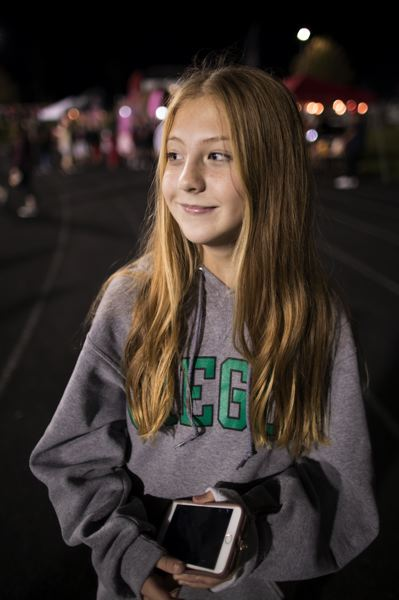 PAMPLIN MEDIA GROUP: JAIME VALDEZ - Morgan Brunner, 13, attended a Clackamas High School football game in mid-October, a year after she received a concussion while warming up for a futsal game. She said she didnt feel completely back to normal until last January.