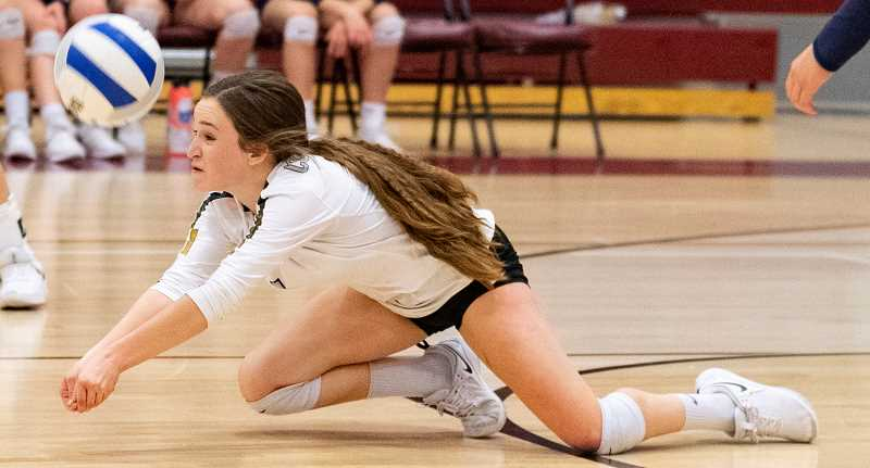 LON AUSTIN/CENTRAL OREGONIAN -  Stormie Camara dives for a ball during the Cowgirls' win last Thursday night at Redmond. Camara, who is normally a defensive specialist, played libero for the Cowgirls in the match and finished with a team-high 11 digs.