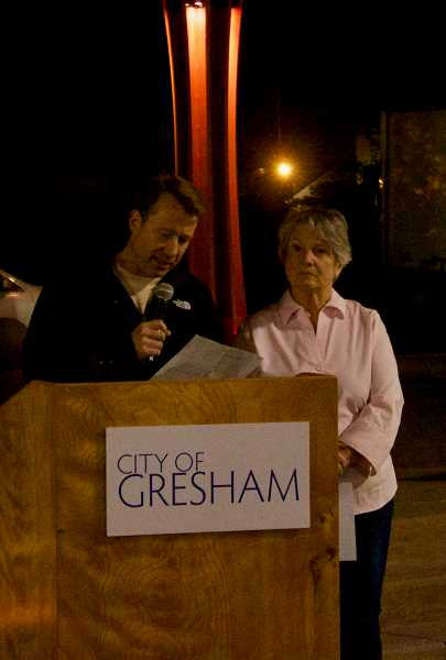 OUTLOOK PHOTO: CHRISTOPHER KEIZUR - Gresham Mayor Shane Bemis read a proclamation during the vigil, which is hosted yearly by Rep. Carla Piluso.