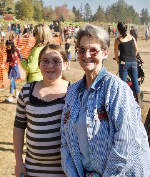 OUTLOOK PHOTO: CHRISTOPHER KEIZUR - Leah, 10, and her mentor Carole Linneman had a fun day at Liepold Farms during a Family of Friends mentoring outing Sunday, Oct. 21.