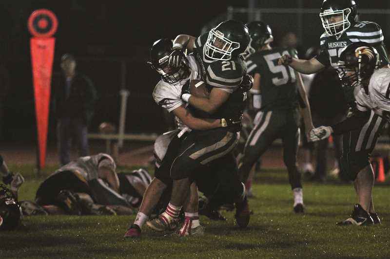 PHIL HAWKINS - North Marion senior Sam Garcia carried the ball 24 times for 164 yards and two touchdowns, and led the team in receiving with a 48-yard touchdown reception in the first quarter of the Huskies' 40-18 win over The Dalles on Friday.