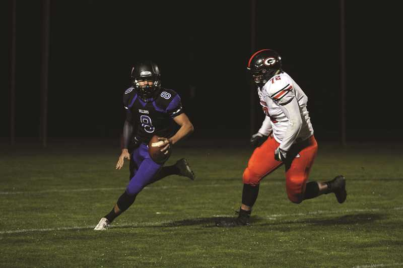 PHIL HAWKINS - Woodburn quarterback Nate Corpuz (pictured) and receiver Luis Rodriguez connected five times for 143 yards and a touchdown in the Bulldogs' 30-28 loss to the No. 2 Gladstone Gladiators on Friday.