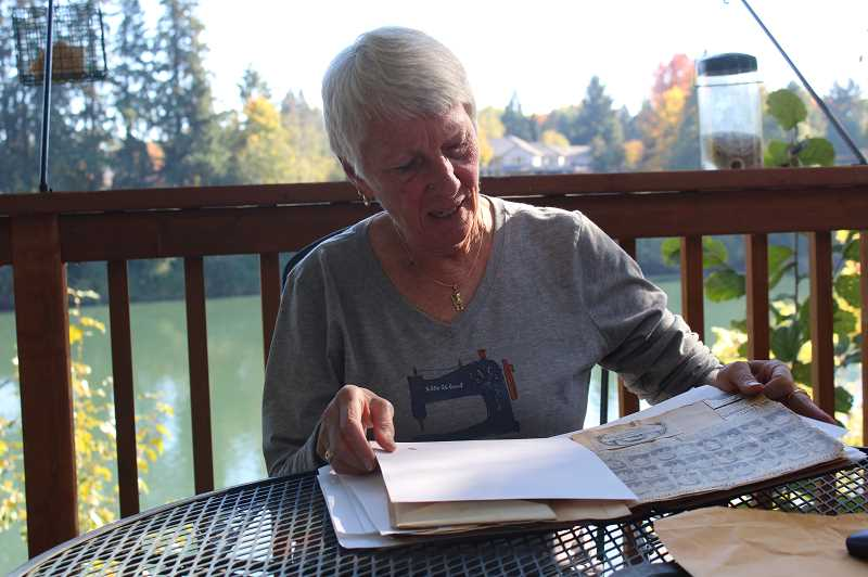 SPOKESMAN PHOTO: COREY BUCHANAN - Cathie Gleeson recently received a scrapbook previously stored in the Wilsonville-Boones Ferry Historical Society archives that depicts the earlier years of her fathers life growing up in Portland.