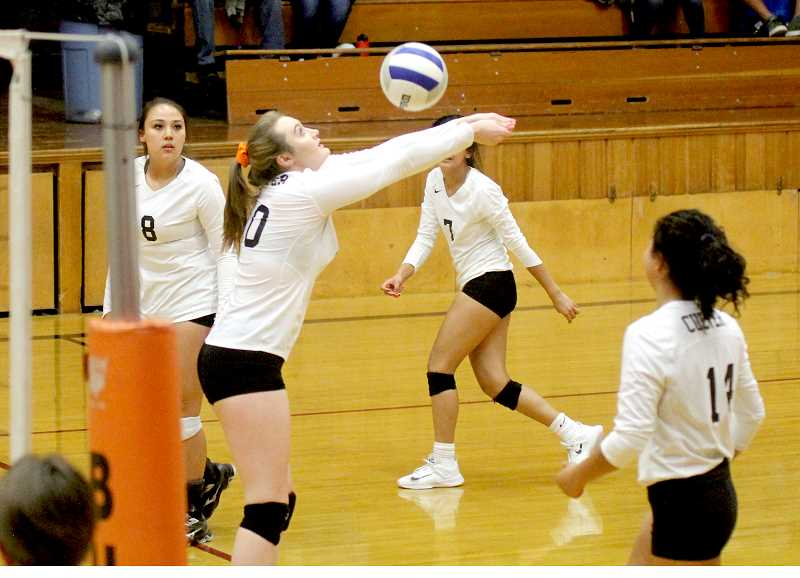 STEELE HAUGEN - Senior Madison Miller returns the ball for CHS. She led the team in kills with 12 to help CHS beat Santiam.