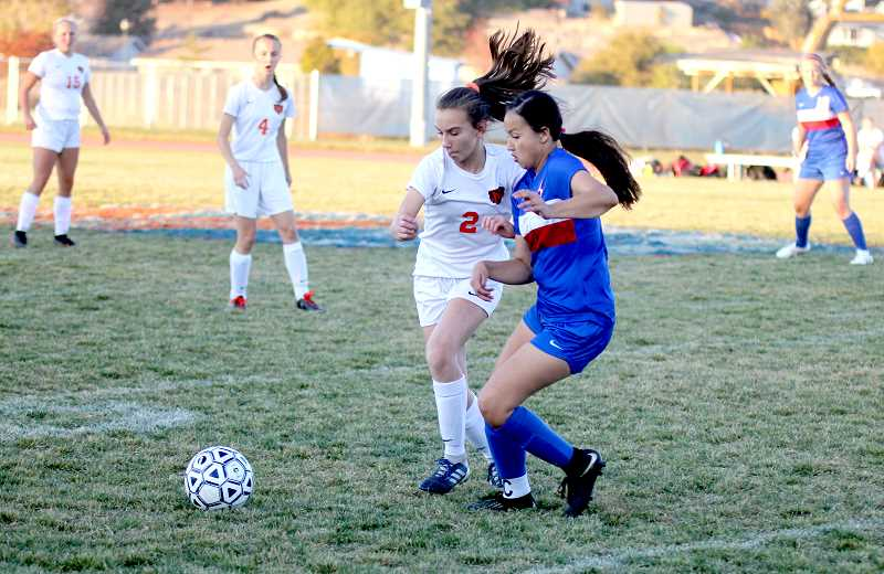 STEELE HAUGEN - Jalaney Suppah tries dribbling past a Molalla defender. The Buffs lost 2-1 on senior night.