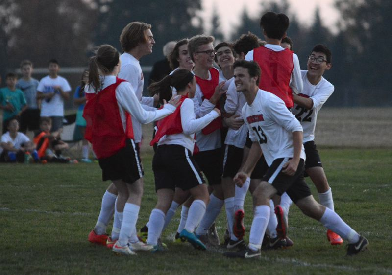 OUTLOOK PHOTO: DAVID BALL - Horizon Christian players celebrate after seeing Luke Hardins penalty shot wrinkle the lower left corner of the goal for a 2-1 win over Damascus Christian in Mondays District 7 semifinals.