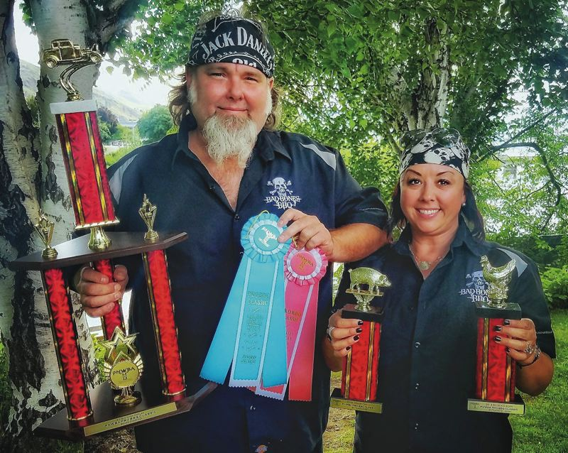 SUBMITTED PHOTO - During this September's Showdown at Juarez Canyon in Oregon City, Shelly and Brian Gurney finished third overall and were named grand champion of the four side categories. Bad Bones BBQ has won six Oregon championships and five in Washington.