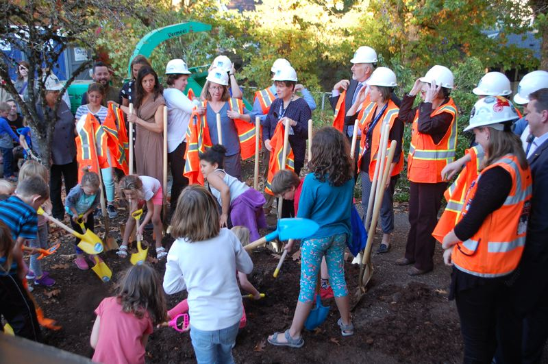 PHOTO BY: RAYMOND RENDLEMAN - Kids with smaller shovels joined adults with traditional golden shovels at the Milwaukie Ledding Library groundbreaking.