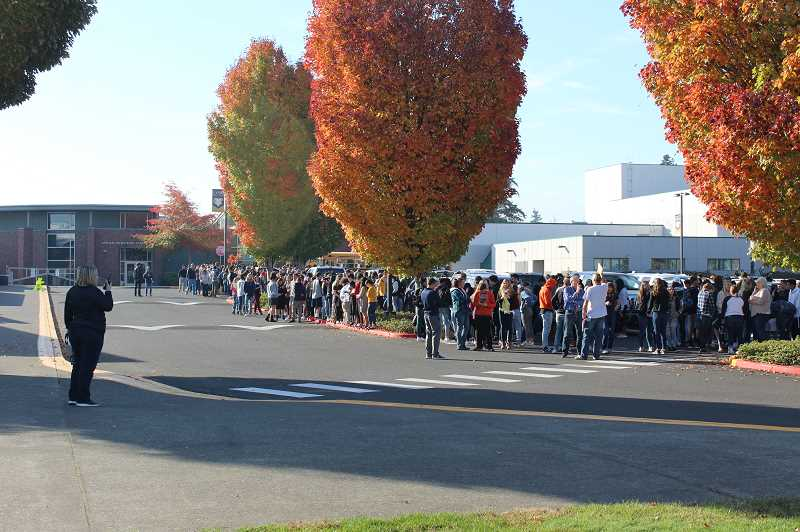 HERALD PHOTO: KRISTEN WOHLERS - Students at Canby High School evacuated the building after the Great Oregon ShakeOut earthquake drill on Oct. 18.