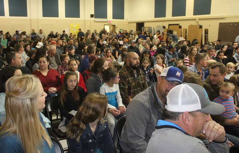 SUSAN MATHENY/MADRAS PIONEER - A crowd of parents and relatives estimated at 300 packed the Buff Elementary cafeteria on Monday night for the regular meeting of the Jefferson County 509-J School District.