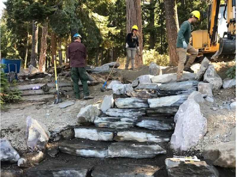 SUBMITTED PHOTO - A U.S. Forest Service trail and road crew works to replace rotting logs with stones along a segment of the Suttle Lake Trail, which loops around Suttle Lake. The recently completed project is expected to enhance bank stabilization and create erosion control.