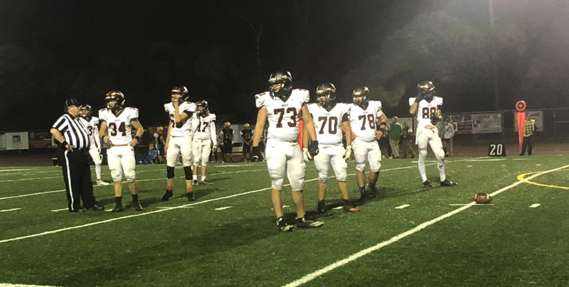 PAMPLIN MEDIA GROUP PHOTO: STEVE BRANDON - Scappoose defensive players get ready for a snap in last weeks game at Cleveland. From left: Drake Kramer (3), Matt Roth (34), Slater Smiens (66), Ben Anicker (17), Robert Vanek (73), Robert Guajardo (70), Blake Carlascio (78) and Gavin Larson (88).