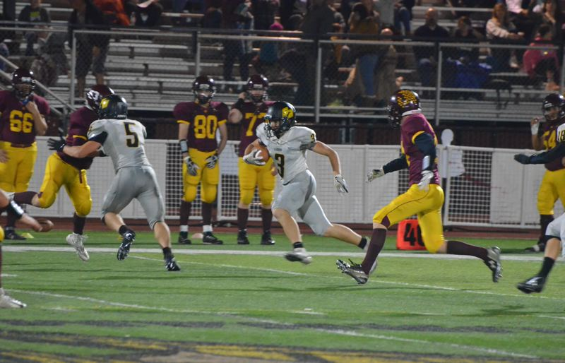 PHOTO COURTESY: JOHN BREWINGTON - Austin Waite returns an interception for St. Helens in its Oct. 19 win at Forest Grove.