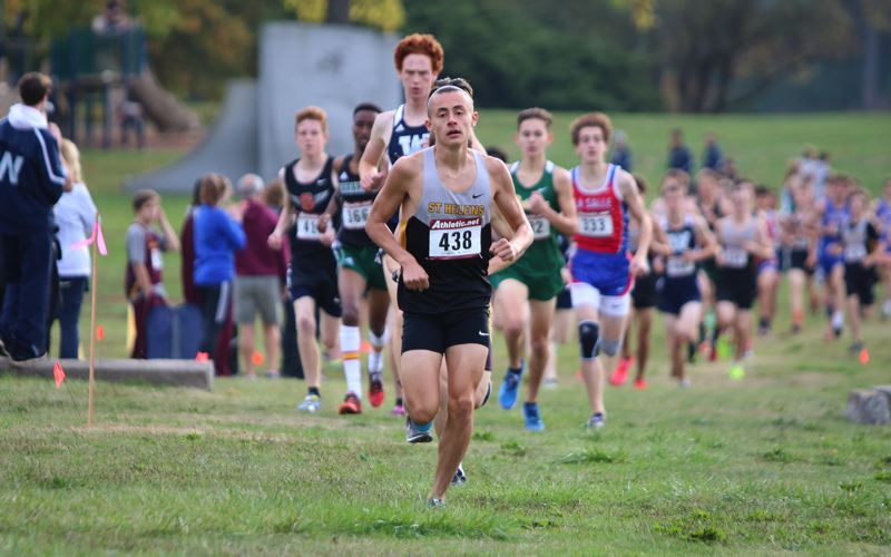 PAMPLIN MEDIA GROUP PHOTOS: JIM BESEDA - St. Helens' Waylon Nichols ran second in the early stages of Wednesday's district race at Blue Lake Park.