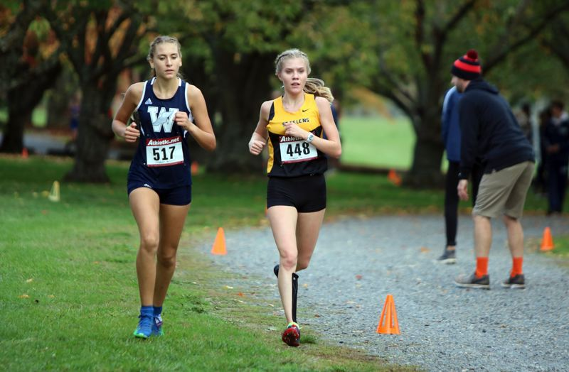PAMPLIN MEDIA GROUP PHOTO: JIM BESEDA - Wilsonville's Gabriella Prusse (left) and St. Helens' Mackenzie Trainer wage a battle for fourth place near the midway point of Wednesday's Northwest Oregon Conference cross-country championships at Blue Lake Park.
