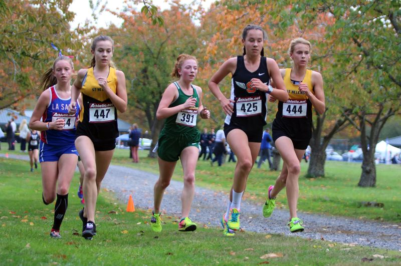 PAMPLIN MEDIA GROUP PHOTO: JIM BESEDA - From left, La Salle Prep's Erin McGinnis, St. Helens' Cheyenne Trainer, Putnam's Madeline Gable, Scappoose's Sydney Hanke and St. Helens' Hannah Hayduk press one another during the second mile of Wednesday's 3.1-mile race at Blue Lake Park.