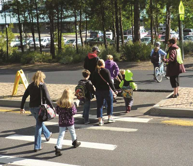 PHOTO COURTESY OF COMMUTE OPTIONS - Students participate in a Walking School Bus with an adult leader. Commute Options, the Crook County Health Department, and Crooked River Elementary have partnered to offer the free program in Prineville.