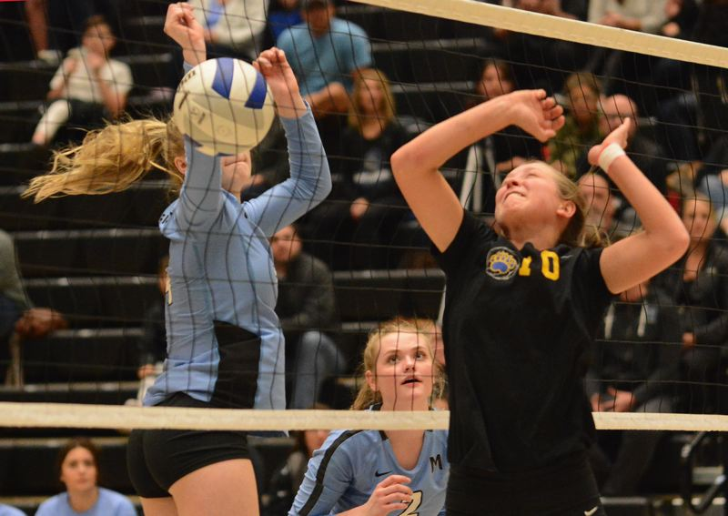 OUTLOOK PHOTO: DAVID BALL - Barlows Sammie Pemberton sees the ball fall on the other side of the net after winning a first-set duel with Mountainsides Katelyn Redell.