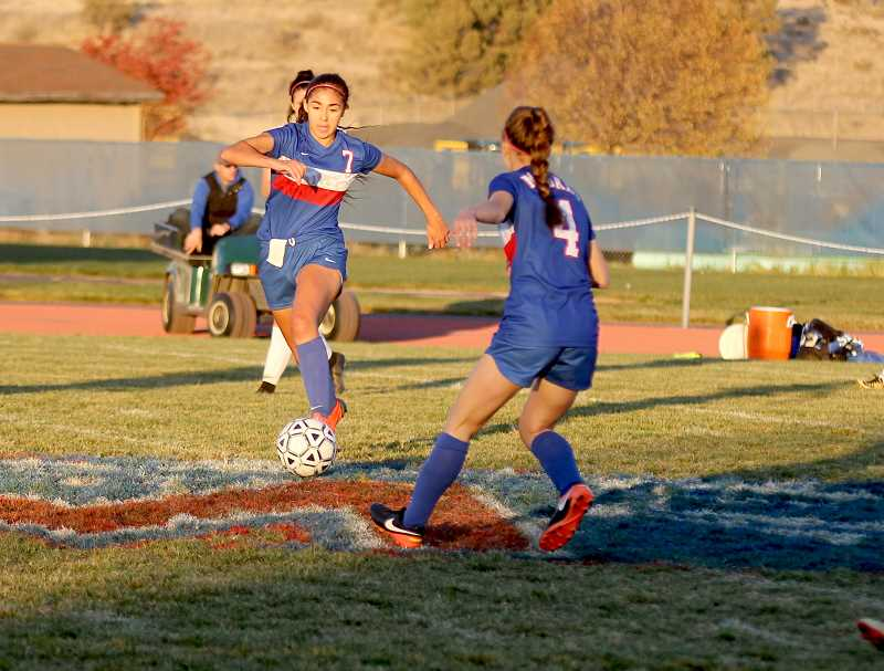 STEELE HAUGEN - Erika Olivera takes the ball to the middle of the field.