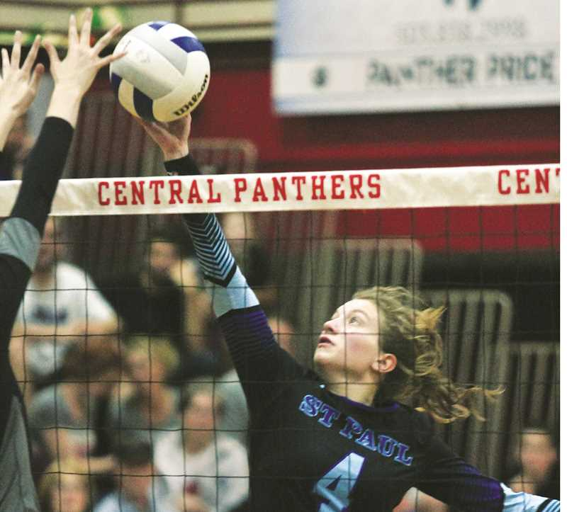 PHIL HAWKINS -- WOODBURN INDEPENDENT - St. Paul junior Erin Counts tips the ball over the net in the final set of the Buckaroos' 3-0 win over Perrydale in the Casco Tournament championship game on Saturday.