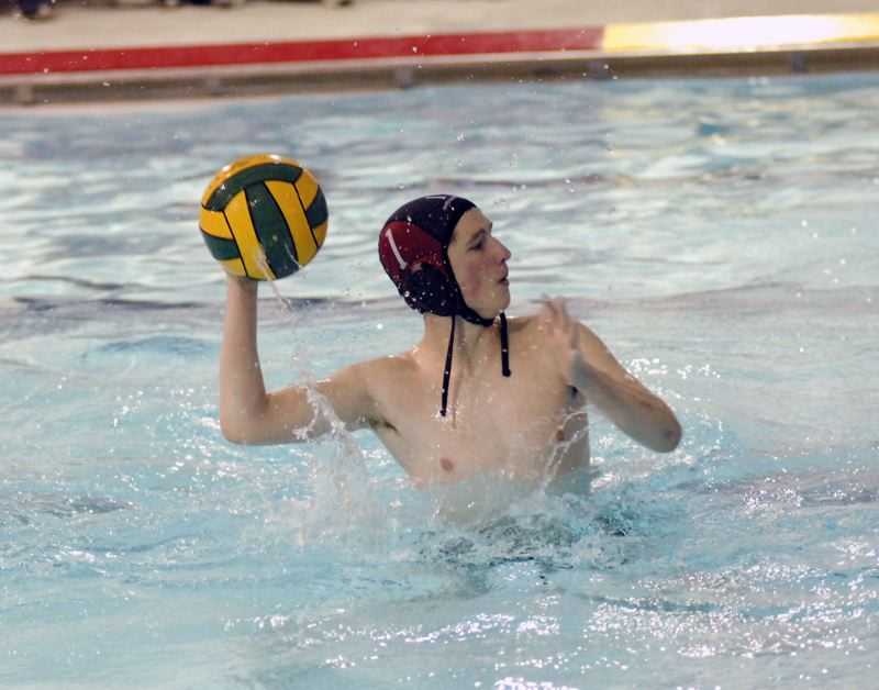 GRESHAM OUTLOOK: MATT RAWLINGS - Reynolds goalie Maxwell Fleshman looks to advance the ball up the pool after making a save.