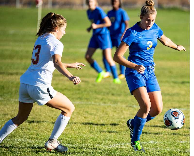 LON AUSTIN/CENTRAL OREGONIAN - Faith Wagner controls the ball during a game earlier this year. Wagner helped lead the Crook County offensive attack on Tuesday as the Cowgirls played the Ridgeview Ravens.
