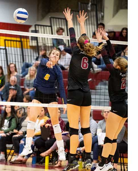 LON AUSTIN/CENTRAL OREGONIAN - Raegan Wilkins goes up for a kill in a match earlier this year. Wilkins led the Cowgirls with 26 kills Tuesday at Pendleton.