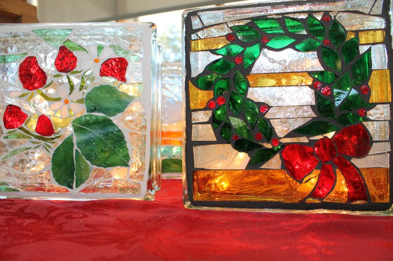 OUTLOOK PHOTO: ANNE ENDICOTT - Stained glass artist Terri Boris embellishes glass blocks with Christmas designs that are lit from the inside with twinkle lights.