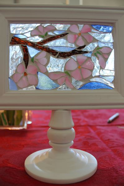 OUTLOOK PHOTO: ANNE ENDICOTT - Stained glass artist Terri Boris uses a mosiac-style pattern with colored glass for small table-top decorations that will bring color to a room year round.