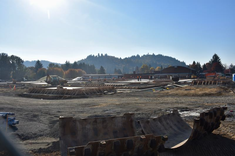 OUTLOOK PHOTO: TERESA CARSON - Workers at East Gresham Elementary School are still working on the foundations of the new school and expect to tip up the walls on Nov. 5.