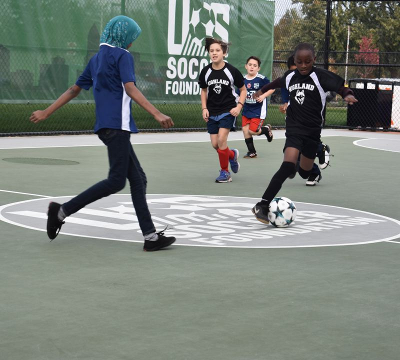 OUTLOOK PHOTO: TERESA CARSON - The new futsal pitch at Wilkes Elementary School supports a game right after its official opening on Tuesday, Oct. 23.