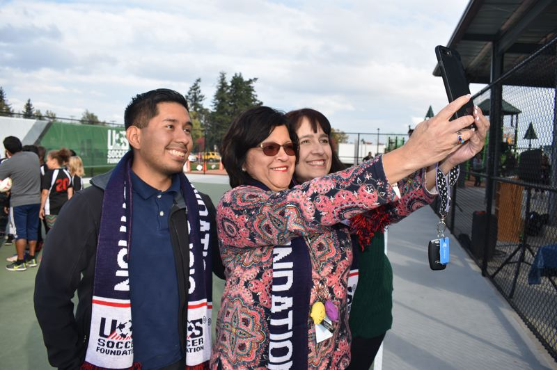 OUTLOOK PHOTO: TERESA CARSON - To mark the opening of the futsal pitch, Reynolds School District Superintendent Danna Diaz snaps a selfie with Ricki Ruiz, a school board member, and Valerie Tewksbury, chairwoman of the school board.
