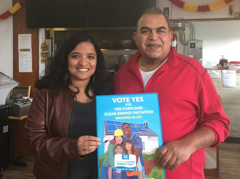 COURTESY: YES FOR PORTLAND CLEAN ENERGY FUND - Spice Kitchen Manager Harry Lal, right, stands with Shweta Moorthy, a staffer of Coalition of Communities of Color and supporter of Measure 26-201, to express his new position on the measure.