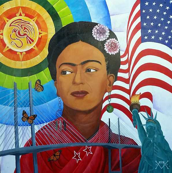 PHOTO COURTESY: LINDA HOLLAND - Arturo Villaseñor, a featured artist at First Tuesday Art Walk, created a mural by M and M Marketplace on Walnut Street of famous Mexican artist Frida Kahlo.