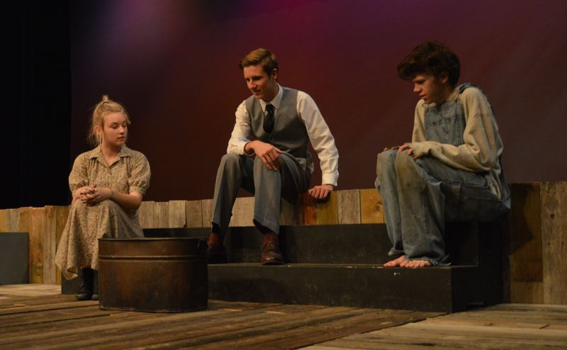 SPOTLIGHT PHOTO: NICOLE THILL-PACHECO - Scappoose students Cassidy Anicker, Chase Hackenberg and Steven Hilts, pictured here, act as characters Jennie Mae Layman, C.C. Showers and Buddy Layman, respectively, in the theater's fall production of 'The Diviners.'