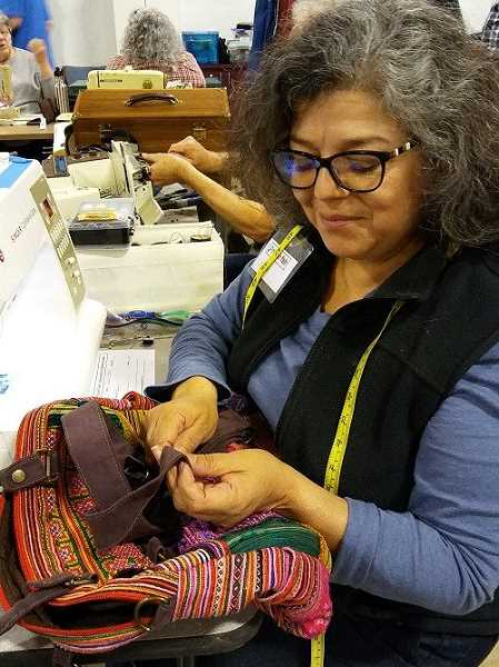 COURTESY PHOTO: REPAIR FAIR - The fix-it clinic has about 15 volunteers all skilled in different areas like mending.