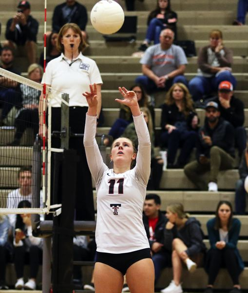 TIMES PHOTO: DAN BROOD - Tualatin junior Jackie Phillips sets the ball during the Wolves four-set state playoff win over Roseburg.