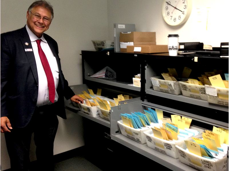 OREGON CAPITAL BUREAU: CLAIRE WITHYCOMBE - Marion County Clerk Bill Burgess shows some of the ballots returned as of Friday morning, Oct. 26. Voters are returning ballots a little slower than in 2016, a presidential election year.