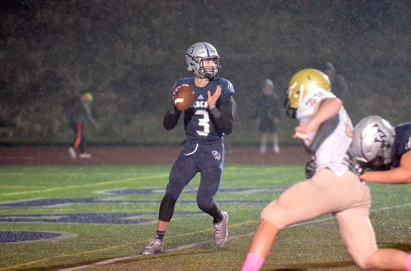 SPOKESMAN PHOTO: TANNER RUSS - Wilsonville's senior quarterback scored seven touchdowns against the Pendleton football team in a battle for the league title. Wilsonville dominated Pendleton 53-7 after 48 minutes of play on Oct. 26.