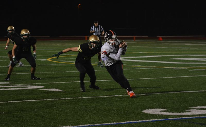 TIMES PHOTO: MATT SINGLEDECKER - Beaverton senior Ben Mackinnon makes a catch along the left sideline against Jesuit.