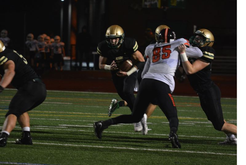 TIMES PHOTO: MATT SINGLEDECKER - Jesuit junior Andy Alfieri makes his way upfield in the first half against Beaverton.