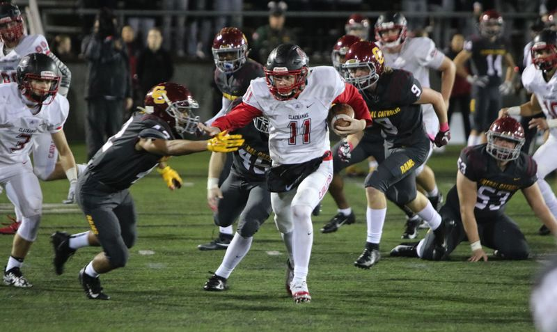 PAMPLIN MEDIA: JIM BESEDA - Clackamas' Austin Atkeson breaks loose on a 34-yard touchdown run in the second quarter of Friday's 24-22 win over Central Catholic in the Mt. Hood Conference championship game at Hillsboro Stadium.
