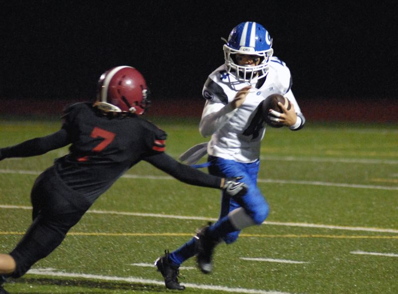 GRESHAM OUTLOOK: MATT RAWLINGS - Gresham's Noah Anderson dodges a Sandy tackler and continues to run upfield.