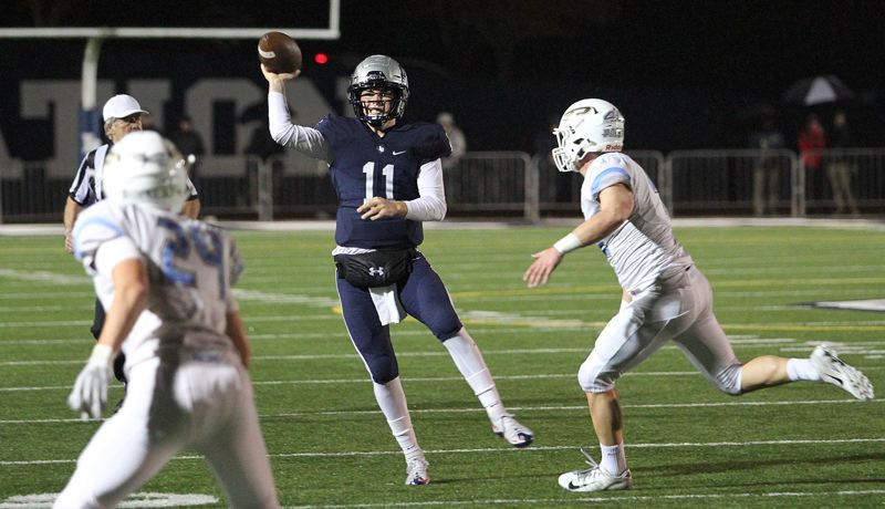 REVIEW PHOTO: MILES VANCE - Lake Oswego senior quarterback Jackson Laurent makes a throw during his team's 30-14 win over Lakeridge at Lake Oswego High School on Friday night.
