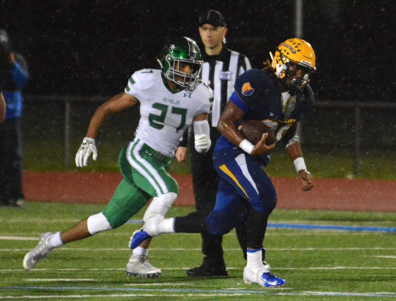 OUTLOOK PHOTO: DAVID BALL - Barlow running back Jobi Malary moves past Reynolds DAndre Katz for a 64-yard touchdown to put the Bruins on top 47-27 early in the fourth quarter. Malary made seven trips to the end zone.