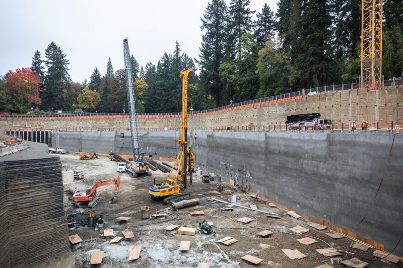 TRIBUNE PHOTO: JONATHAN HOUSE - Work continues on the Washington Park Reservoir Improvement Project. For safety, plywood boards cover the holes drilled for pilings, which can go down 90 feet.