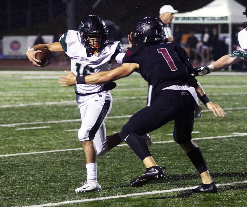 TIMES PHOTO: DAN BROOD - Tigard junior Max Lenzy (left) looks to get past Tualatin senior Jett Searle during Friday's game.