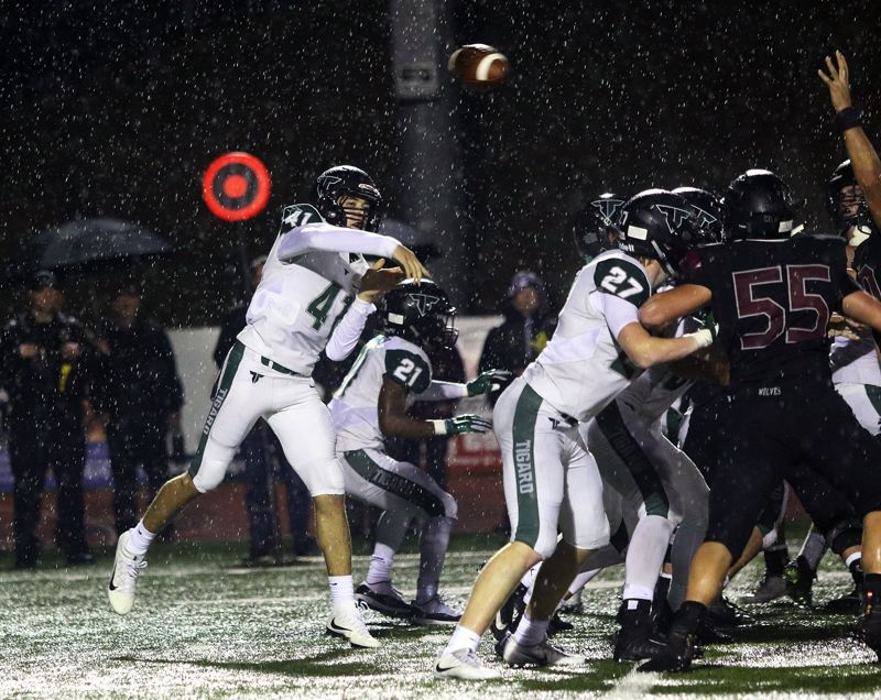 TIMES PHOTO: DAN BROOD - Tigard sophomore quarterback Drew Carter flings a pass during Friday's game at Tualatin.