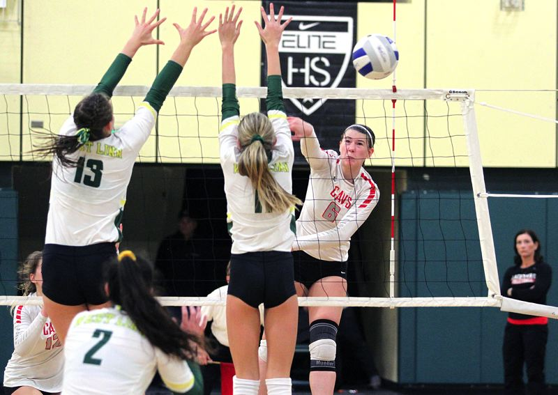 PAMPLIN MEDIA GROUP PHOTO: MILES VANCE - Clackamas junior Jayla Parnell makes an attack during her team's four-set loss at West Linn in the second round of the Class 6A state playoffs on Saturday.