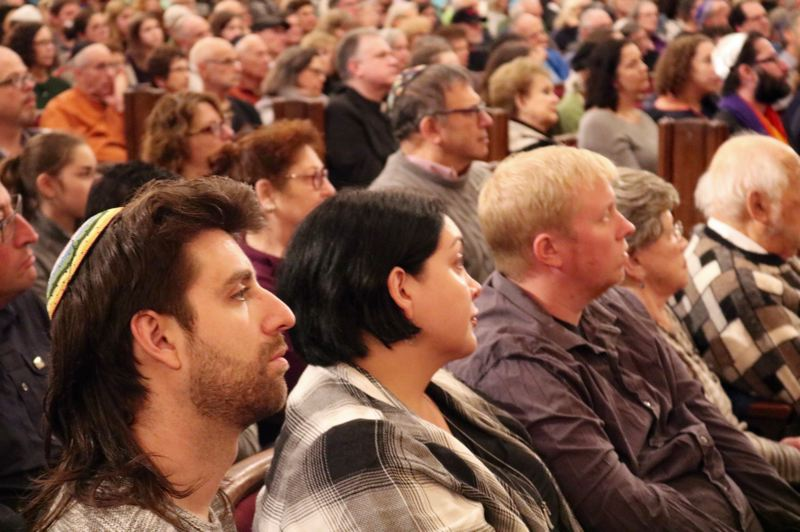 TRIBUNE PHOTO: ZANE SPARLING - A standing-room-only crowd of hundreds filled the sanctuary and upper balcony at Congregation Beth Israel in Portland on Sunday, Oct. 28.